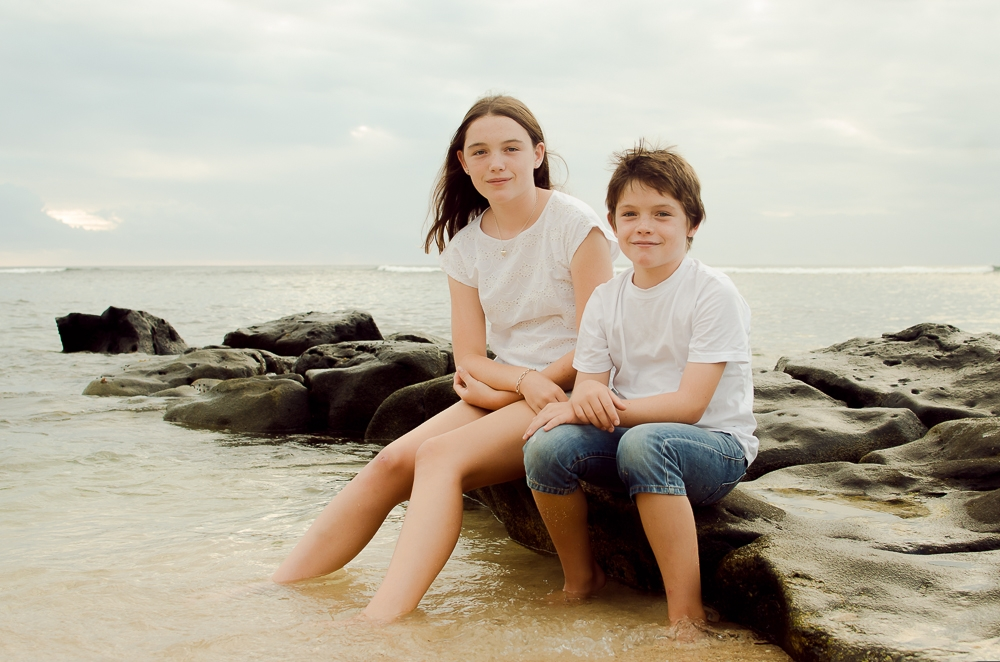 brother and sister posing on the rocks in Mauritius